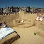 Emily Keogh poses for a photograph inside the world's first sand hotel on Weymouth beach, on July 23 2008 in Weymouth, England. The sand structure, which features twin and double bedrooms, can be booked on a first-come, first-served basis and has been built to celebrate the resurgence in British beach holidays.. Getty Images