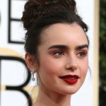 A subtle wash of pink eyeshadow lit up Lily Collins hazel eyes.