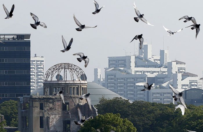 Doves fly over Peace Memorial Park near Atomic Bomb Dome at a 70th anniversary ceremony in Hiroshima REUTERS/Toru Hanai