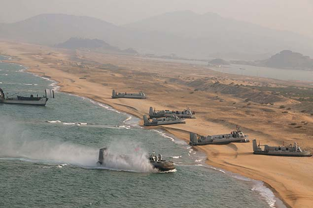 Landing and anti-landing exercises being carried out by the Korean People's Army (KPA) at an unknown location are seen in this undated photo released by North Korea's Korean Central News Agency (KCNA) in Pyongyang on March 20, 2016.        REUTERS/KCNA