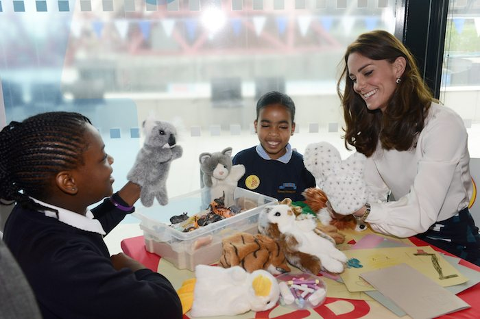 Britain's Kate, the Duchess of Cambridge chats to 9 year old  Eliana Bayan (C) and 10 year old Maggie Fagbohun as she  attend a Heads Together mental health campaign launch in Stratford, East London, May 16, 2016.  REUTERS/Jeremy Selwyn/Pool