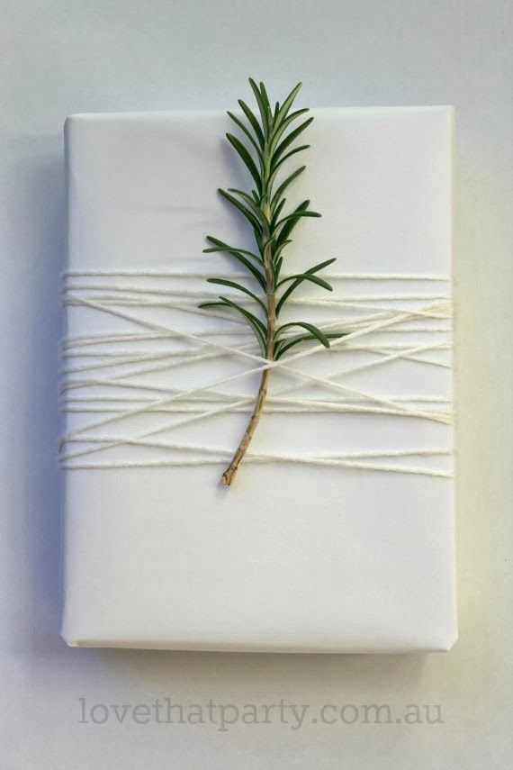 Keep things simple and white with a touch of botany. From lovethatparty.com