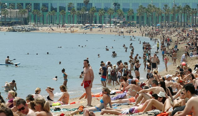 As well as countless pools, Barcelona boasts a beautiful sandy beach, where it's commonplace for women to go topless. REUTERS/Albert Gea
