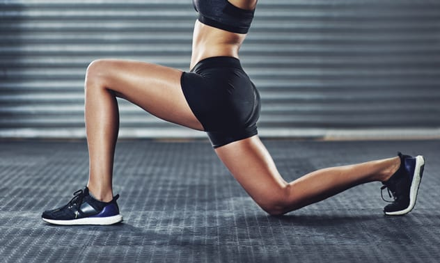 Lunges can be done without any equipment, but throwing in some dumbbells can be a great way of pushing your strength, stability and coordination even further. ISTOCK