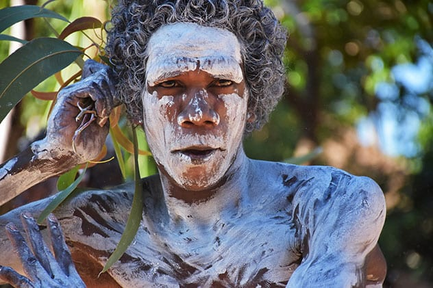 A Yolgnu local with his face and body smeared in white ochre. BELINDA LUKSIC