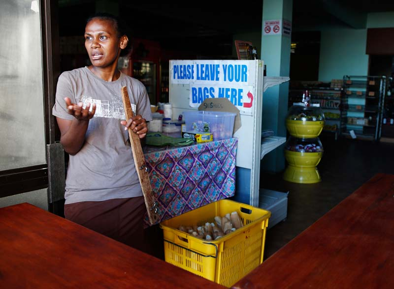 A storekeeper talks about the shortage of food at a grocery store operating without electricity in Port Vila, capital city of the Pacific island nation of Vanuatu